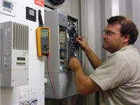 One of WA Solar Supplies' experts checking and servicing the solar power system