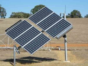 A solar tracking system planted on an open field with pump bore attached to it