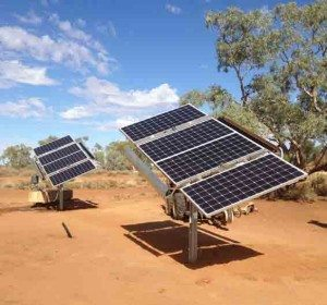 2 solar tracking water pumps attached to a grid of solar panels with 4 collectors in each panel