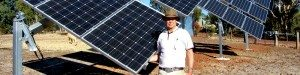 One of WA Solar Supplies' team member posing for a picture holding a solar panel