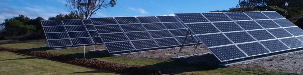 A set of 3 grids with 20 solar panels attached to each grid plaed on an open field