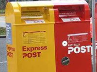A cropped image showing two post boxes, one in red and the other in yellow